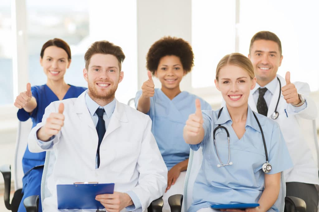 group of happy doctors on seminar at hospital
